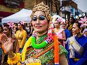 "29 APRIL 2017 - MINNEAPOLIS, MINNESOTA: People in traditional Thai outfits participate in Songkran Uptown parade. Several thousand people attended Songkran Uptown on Hennepin Ave in Minneapolis for the city's first celebration of Songkran, the traditional Thai New Year. Events included a Thai parade, a performance of the Ramakien (the Thai version of the Indian Ramayana), a ""Ladyboy"" (drag queen) show, and Thai street food.     PHOTO BY JACK KURTZ"