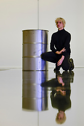 """© Licensed to London News Pictures. 07/11/2019. LONDON, UK.  British artist Patrick Staff poses with his work """"On Venus"""", a site-specific exhibition commissioned by the Serpentine Sackler Gallery.  Altered lighting and reflective flooring combined with natural and synthetic liquids leaking from ceiling piping into steel barrels forms the major installation.   The exhibition, which also includes etchings and video work, runs 8 November to 9 February 2020.  Photo credit: Stephen Chung/LNP"""