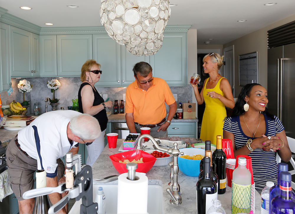 Guests mingle before dinner at a party hosted by Leanne Powers in Blasdell, N.Y. on August 24, 2014. Powers has been forced to cut back on some of her dinner offerings due to food price increases. From left, Mike Mattioli, Carol Mattioli, Dennis Powers, Leanne Powers, and Gwen McQuiller. CREDIT: Mike Bradley for the Wall Street Journal<br /> PRICES