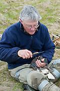 Waterfowl biologist, Dr. Jim Sedinger measuring Black Brant; Branta bernicla nigricans, Tutakoke River research camp, Yukon Delta NWR, Alaska