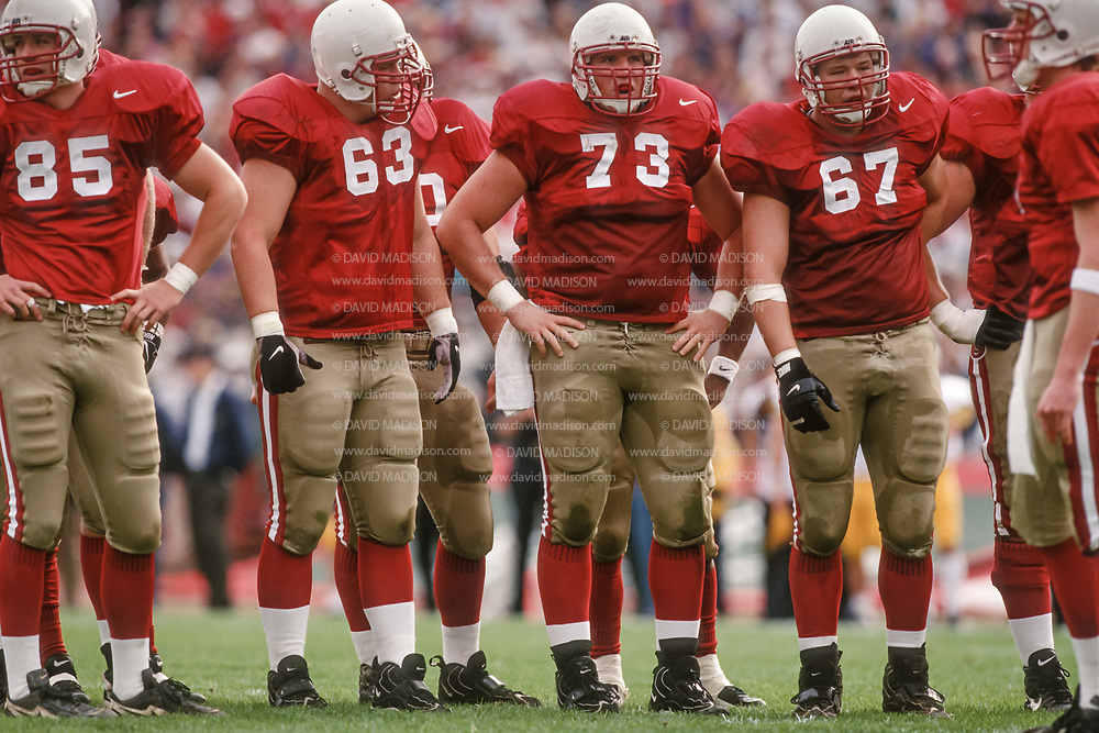 COLLEGE FOOTBALL:  Stanford offensive line waits between plays during the Stanford vs Cal Big Game on Nov 22, 1997 at Stanford Stadium in Palo Alto, California.  Geoff Wilson #65, Andrew Kroeker #63, Mike McLaughlin #73, Joe Fairchild #67, Jeff Cronshagen #79.  Photograph by David Madison(WWW.DAVIDMADISON.COM).