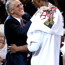 Jun 21, 2012; Miami, FL, USA; Miami Heat president Pat Riley celebrates with power forward Chris Bosh (1) after winning the 2012 NBA championship against the Oklahoma City Thunder at the American Airlines Arena. Miami won 121-106. Mandatory Credit: Derick E. Hingle-US PRESSWIRE