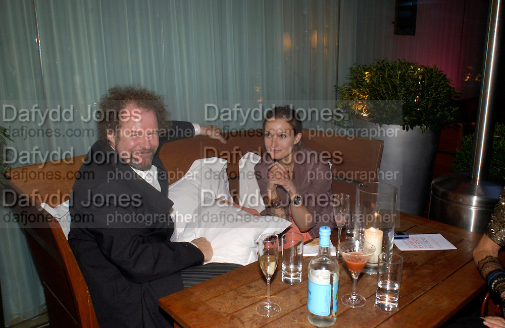 Mike Figgis and Daisy Bates, 'An Evening at Sanderson' in aid of Sargent, Sanderson Hotel. 7 July 2004. SUPPLIED FOR ONE-TIME USE ONLY-DO NOT ARCHIVE. © Copyright Photograph by Dafydd Jones 66 Stockwell Park Rd. London SW9 0DA Tel 020 7733 0108 www.dafjones.com