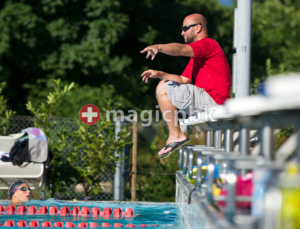 Dirk REINICKE, coach of the Swiss Olympic Swim Team for London 2012, is pictured while coaching his swimer Martina van Berkel, (bottom) during a training session at the 50m outdoor training pool at the Centro sportivo nazionale della gioventu in Tenero, Switzerland, Wednesday, July 18, 2012. (Photo by Patrick B. Kraemer / MAGICPBK)