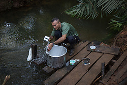 El Diamante, Meta, Colombia - 16.09.2016        <br /> <br /> A small river serves as a bath and washing area. 10th conference of the marxist FARC-EP in El Diamante, a Guerilla controlled area in the Colombian district Meta. Few days ahead of the peace contract passing after 52 years of war with the Colombian Governement wants the FARC decide on the 7-days long conferce their transformation into a unarmed political organization. <br /> <br /> Ein kleiner Fluss dient als Bad und Waschbereich. Zehnte Konferenz der marxistischen FARC-EP in El Diamante, einem von der Guerilla kontrollierten Gebiet im kolumbianischen Region Meta. Wenige Tage vor der geplanten Verabschiedung eines Friedensvertrags nach 52 Jahren Krieg mit der kolumbianischen Regierung will die FARC auf ihrer sieben taegigen Konferenz die Umwandlung in eine unbewaffneten politischen Organisation beschlieflen. <br />  <br /> Photo: Bjoern Kietzmann