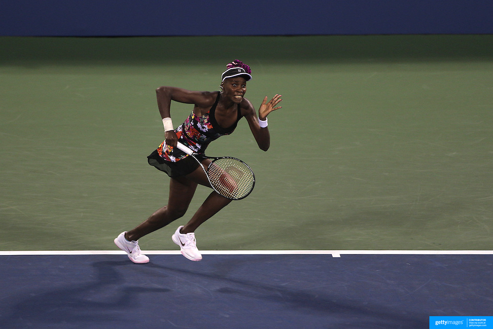 Venus Williams, USA, in action against Jie Zheng, China, on Louis Armstrong Stadium during the Women's Singles competition at the US Open. Flushing, New York, USA. 28th August 2013. Photo Tim Clayton
