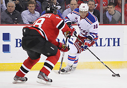 Mar 6; Newark, NJ, USA; New York Rangers right wing Marian Gaborik (10) skates with the puck while being defended by New Jersey Devils defenseman Anton Volchenkov (28) during the first period at the Prudential Center.
