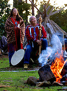 Steve and Cindy Vincent of Falls, City, Oregon, await the darkness while sitting about their sacred fire circle.They are Winnimem Wintu Indians and have a sacred fire circle, sweat lodge and teepee  overlooking the Willamette forest land just below their property.
