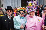 New York, NY - 21 April 2019. Three men in elaborate hats and colorful suits at the Easter Bonnet Parade and Festival on New York's Fifth Avenue.
