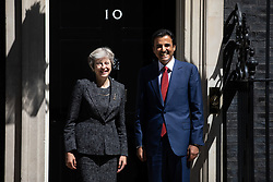 © Licensed to London News Pictures. 24/07/2018. London, UK. British Prime Minister Theresa May meets the Emir of Qatar Tamim bin Hamad Al Thani in Downing Street for talks and a working lunch. Controversy has arisen after a casting agency were found to be advertising for paid extras to demonstrate outside the meeting. The casting agency has since removed the advert. Photo credit : Tom Nicholson/LNP