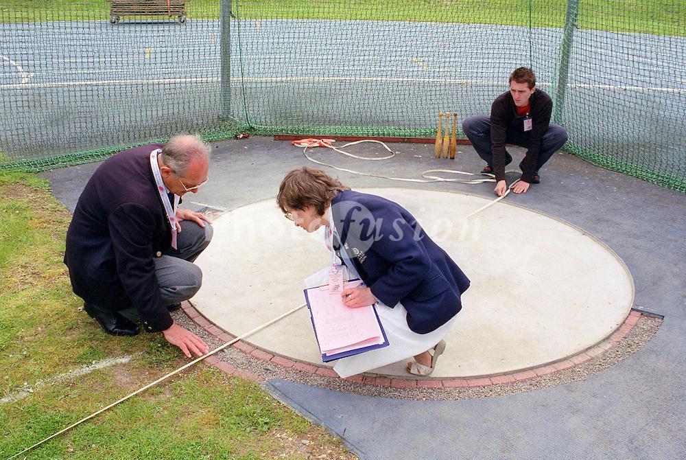 Judges measuring distance at Mini games sports event held at Stoke Mandeville Stadium,