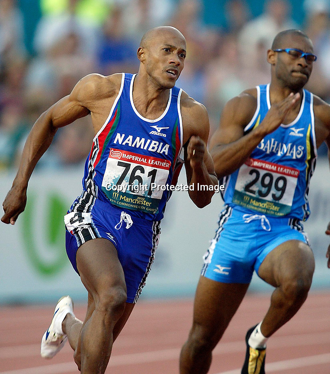 29 July 2002, City of Manchester stadium, Commonwealth Games, Manchester, England. Winner Frankie Fredericks on the bend of the 200m . Dominic Demeritte (R)  <br />Pic: Anthony Phelps/Photosport