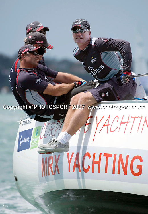 Emirates Team New Zealand tactician Terry Hutchinson (R) hiking hard during day 2 of the Auckland Match Racing Championships held on Auckland Harbour, New Zealand, on Thursday 25 January 2007. Photo: Gareth Cooke/PHOTOSPORT  <br /> <br /> <br /> <br /> 250107