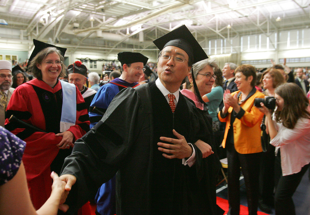 Waltham, MA 05/22/2011<br /> Famed cellist Yo-Yo Ma gestures to a fan as he attends Sunday's Commencement ceremony at Brandeis University.  Ma received an honorary degree.