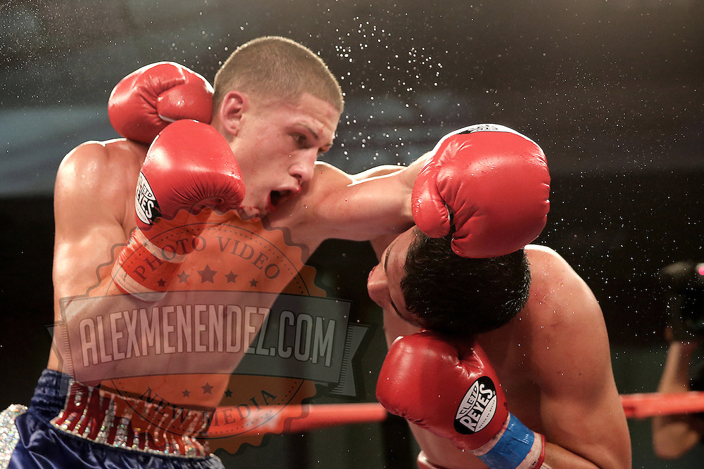 ORLANDO, FL - OCTOBER 04: Esteban Villalba (R) and Anthony Mercado trade punches during a professional super lightweight boxing match at the Bahía Shriners Auditorium & Events Center on October 4, 2014 in Orlando, Florida. (Photo by Alex Menendez/Getty Images) *** Local Caption ***Esteban Villalba; Anthony Mercado