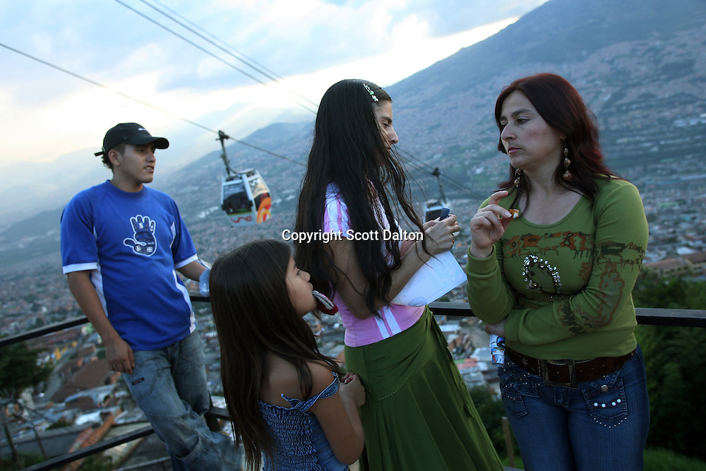 A family enjoys the afternoon in the barrio Santo Domingo Savio, in Medellin on May 19, 2007. (Photo/Scott Dalton)