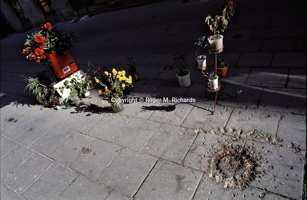 Flowers and a mortar shell impact in the pavement mark the spot where 27 Sarajevans waiting for bread, men, women, children and the elderly, were blown to pieces by 2 Serb shells In May 1992, during the Bosnian Serb siege of Sarajevo, Bosnia and Herzegovina. Almost 2,000 children, and over 10,000 people in total were killed in Sarajevo during the 3-1/2 year siege. (Photo by Roger Richards)