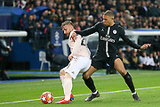 Manchester United Defender Luke Shaw battles with Kylian Mbappe of Paris Saint-Germain during the Champions League Round of 16 2nd leg match between Paris Saint-Germain and Manchester United at Parc des Princes, Paris, France on 6 March 2019.