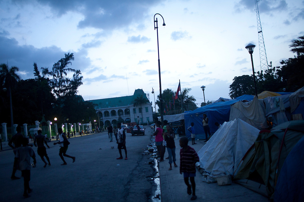 Boys play soccer in front of the destroyed National Palace on July 9, 2010 in Port-au-Prince, Haiti.