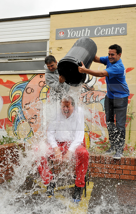 &copy; Licensed to London News Pictures. 26/08/2014; Bristol, UK.  George Ferguson, elected Mayor of Bristol, takes the ice bucket challenge at the Mill Youth Centre run by Empire Fighting Chance.  Chris and Jamie Sanigar of Empire Fighting Chance pour iced water over the mayor.<br /> Photo credit: Simon Chapman/LNP