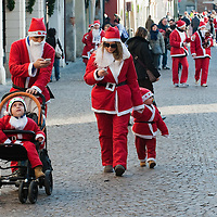 NOALE, ITALY - DECEMBER 18:  Two participants  dressed as Father Christmas send messages on mobile phones as they take part in the Noale Santa Run on December 18, 2011 in Noale, Italy. Close to two thousand people participated in the third annual Noale Santa Run, one of the largest non competitive Santa Run in Italy.
