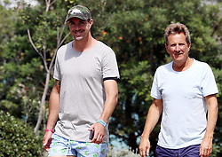 EXCLUSIVE: Former English National Cricketer Kevin Pietersen walks with another former cricketer and commentator Mark Nicholas, KP has recently been in the media, deciding to retire from cricket and trying to help with animal conservation and anti-poaching launching his own charity the logo of which can be seen on the baseball cap he is wearing at Bondi Beach, Sydney, Australia. 10 Feb 2018 Pictured: Kevin Pietersen. Photo credit: Mega TheMegaAgency.com +1 888 505 6342