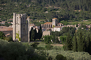 The pre-Romanesque tower of the Abbey of Sante-Marie D'Orbieu and the church of Saint-Michel, on 21st May 2017, in Lagrasse, Languedoc-Rousillon, south of France. Lagrasse is listed as one of France's most beautiful villages and lies on the famous Route 20 wine route in the Basses-Corbieres region dating to the 13th century.