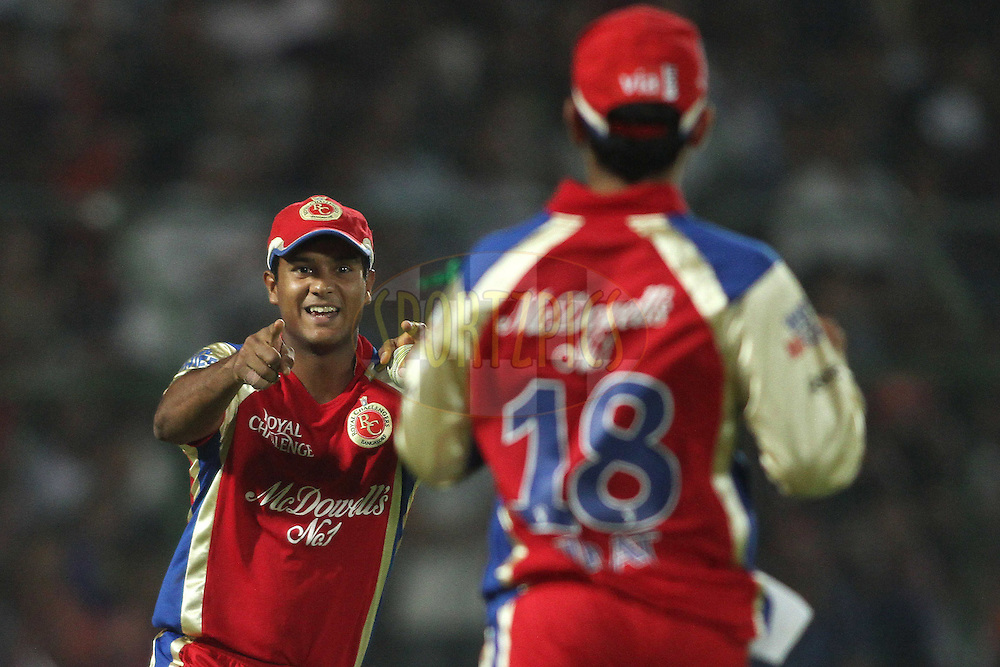 Mayank Agarwal of the Royal Challengers Bangalore celebrates after taking a catch to dismiss Rajasthan Royals captain Rahul Dravid during match 30 of the the Indian Premier League (IPL) 2012  between The Rajasthan Royals and the Royal Challengers Bangalore held at the Sawai Mansingh Stadium in Jaipur on the 23rd April 2012..Photo by Shaun Roy/IPL/SPORTZPICS