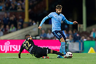 SYDNEY, AUSTRALIA - OCTOBER 27: Sydney FC midfielder Milos Ninkovic (10) is tackled by Western Sydney Wanderers midfielder Rashid Mahazi (22) at The Hyundai A-League Round 1 soccer match between Sydney FC and Western Sydney Wanderers FC The Sydney Cricket Ground in Sydney on October 27, 2018. (Photo by Speed Media/Icon Sportswire)