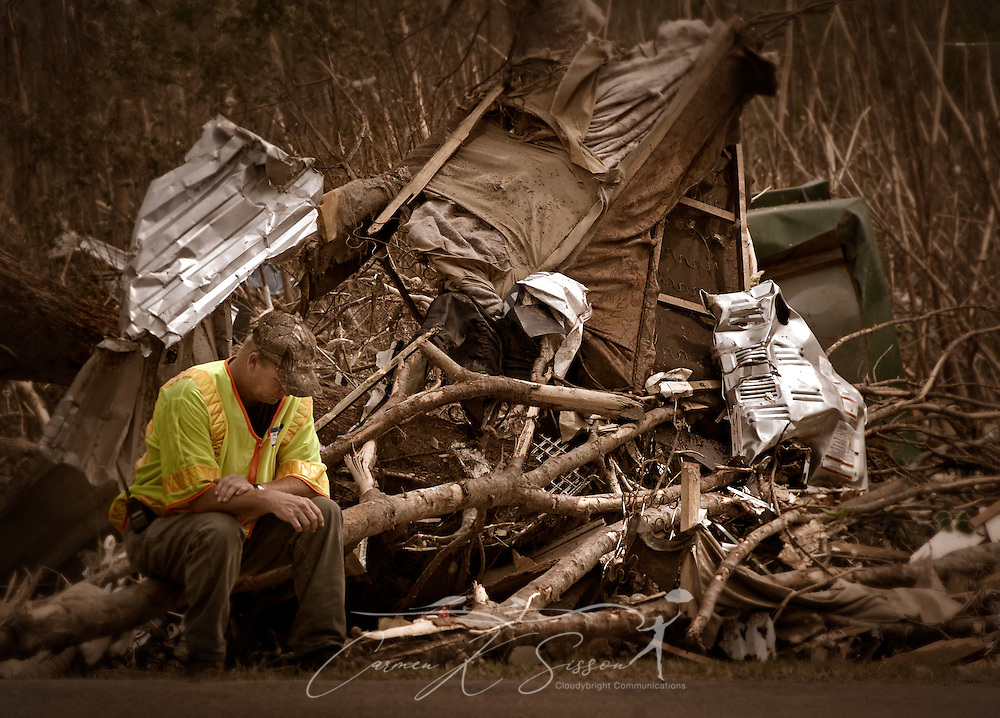 Keith Clayton, of the Tilden New Salem Fire Department, sits among the rubble during an outdoors worship service May 1, 2011 at Smithville Baptist Church in Smithville, Miss. Sixteen people died in the town during the April 27, 2011 EF5 tornado, part of a storm system that swept across six states in the South, killing 342 people and injuring thousands. (Photo by Carmen K. Sisson/Cloudybright)