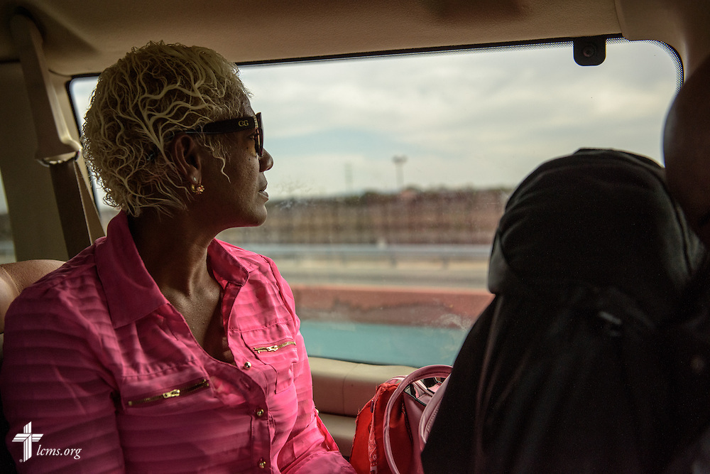 A Cuban immigrant eyes the United States border to Mexico as she rides toward the Greyhound bus station on  Saturday, May 21, 2016, after a stay at Ysleta Lutheran Mission Human Care in El Paso, Texas. LCMS Communications/Erik M. Lunsford