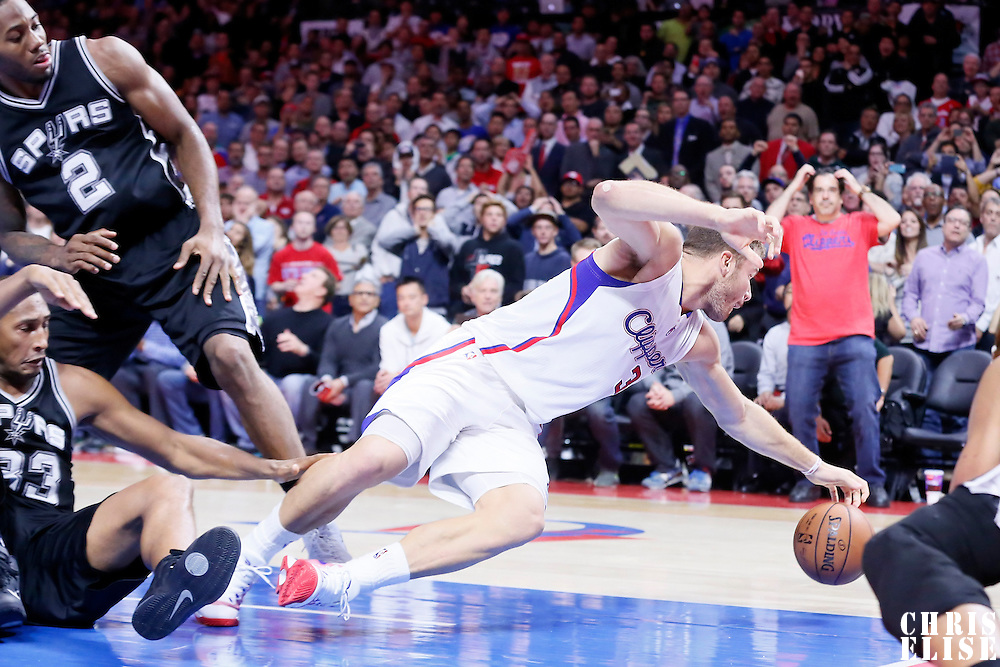 10 November 2014: `Los Angeles Clippers forward Blake Griffin (32) reaches for the loose ball on the last possession during the San Antonio Spurs 89-85 victory over the Los Angeles Clippers, at the Staples Center, Los Angeles, California, USA.