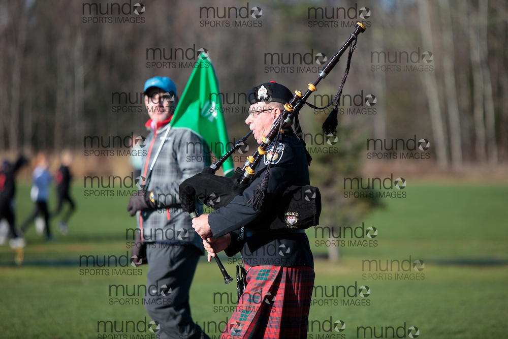 A piper plays at the start of the 2011 OFSAA Cross Country Championships in Ottawa, Ontario, November 5, 2011..GEOFF ROBINS/ Mundo Sport Images