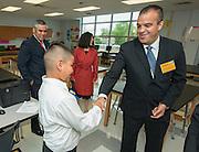 Principal Eduardo Sindaco, right, congratulates sixth grader Adrian Palacios, left, for his presentation during a classroom tour at The Rusk School, April 7, 2014.