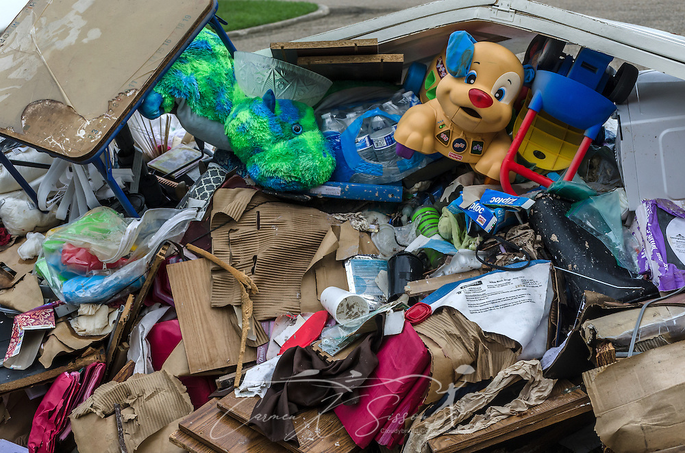 Children's toys lay along the curb with other unsalvageable household items on Woodwick Avenue, Aug. 21, 2016, in Baton Rouge, Louisiana. Approximately 20 parishes in Louisiana experienced severe flooding after receiving torrential rain Aug. 12-15, 2016, and 13 people died. Southern Baptist Disaster Relief, along with numerous other agencies, responded quickly to help with mud out, feeding, and other survivor needs. (Photo by Carmen K. Sisson/Cloudybright)