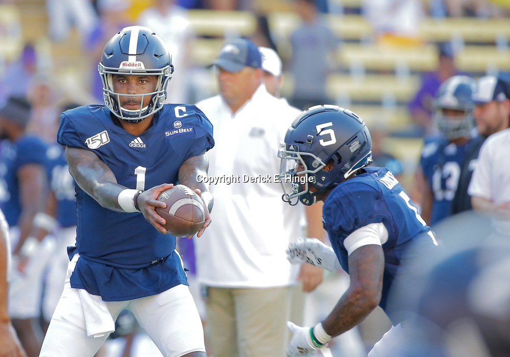 Aug 31, 2019; Baton Rouge, LA, USA; Georgia Southern Eagles quarterback Shai Werts (1) hands off to running back Matt LaRoche (5) during warm ups prior to kickoff against the LSU Tigers at Tiger Stadium. Mandatory Credit: Derick E. Hingle-USA TODAY Sports