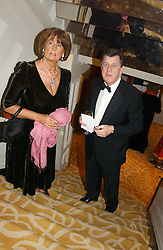 LADY ANNABEL GOLDSMITH and SIMON ELLIOT and at a dinner in aid of the BAAF (British Association for Adoption & Fostering) held at The Savoy, London on 22nd March 2005.<br />