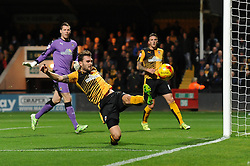 Greg Taylor of Cambridge United clears the ball from danger - Mandatory byline: Dougie Allward/JMP - 07966 386802 - 30/10/2015 - FOOTBALL - The Abbey Stadium - Cambridge, England - Cambridge United v Bristol Rovers - Sky Bet League Two