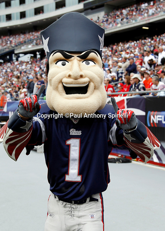 The New England Patriots mascot points out who he thinks is number one during the NFL regular season week 3 football game against the Buffalo Bills on September 26, 2010 in Foxborough, Massachusetts. The Patriots won the game 38-30. (©Paul Anthony Spinelli)