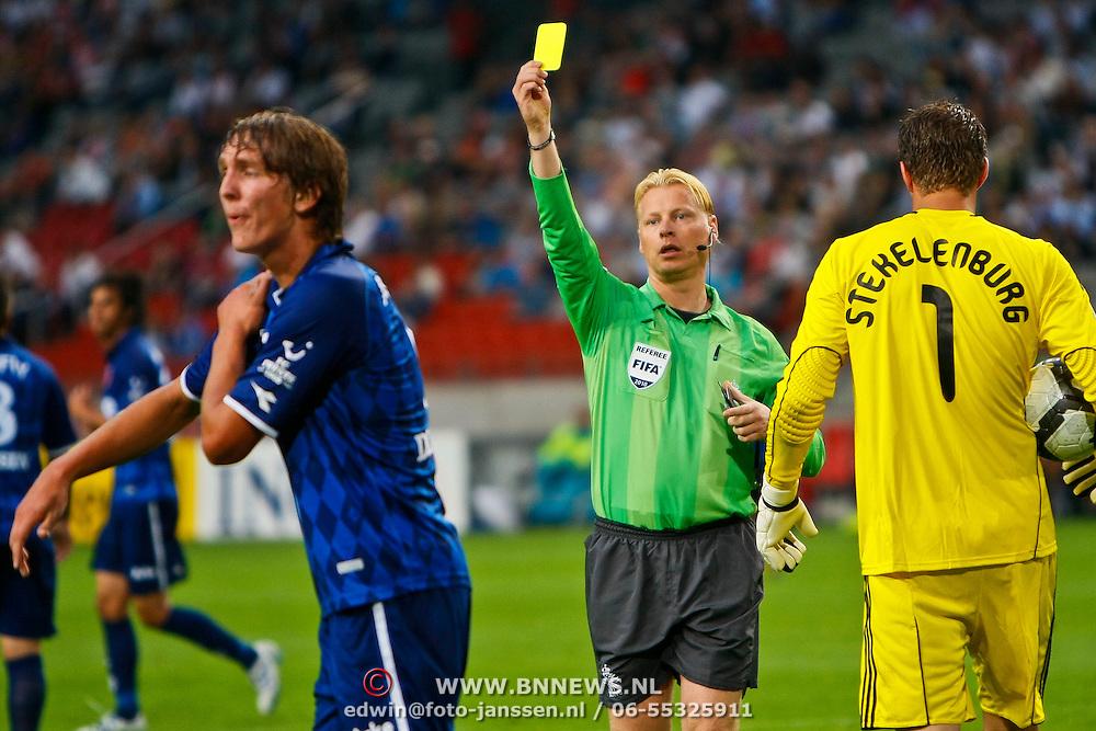 NLD/Amsterdam/20100731 - Wedstrijd om de JC schaal 2010 tussen Ajax - FC Twente, gele kaart voor David Carney van scheidsrechter Kevin Blom