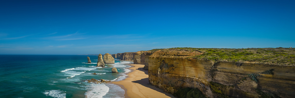 12 Apostles in Port Campbell Coastal Park with clear blue sky