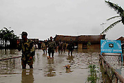 Soldiers of the Indian Border Security Force walk through floodwaters at International Border Village – Banshichar of Dhubri district in Indian State, Assam, which is just near the India-Bangladesh International Border on July 12, 2004. Every year monsoon floods raging in large parts of India, Bangladesh, Nepal, Pakistan and China have killed hundreds of people and stranded millions in their homes. (Photo/Shib Shankar Chatterjee)