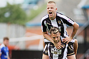 Notts County midfielder Jorge Grant (10) is congratulated by Notts County forward Terry Hawkridge (11)  after scoring his second goal during the EFL Sky Bet League 2 match between Notts County and Chesterfield at Meadow Lane, Nottingham, England on 12 August 2017. Photo by Nigel Cole.