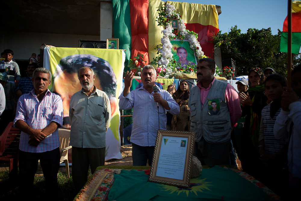 August 12, 2012 - Kafa Safra, Efrin, Syria: A Syrian Kurdish man speeches at the funeral and ceremony of martyrdom of Taliz Gadalum, a Kurdistan Workers' Party (PKK) fighter killed days earlier during combat against the Turkish army...PKK has been fighting an armed struggle against the Turkish state for an autonomous Kurdistan and greater cultural and political rights for the Kurds in Turkey, Iraq, Syria and Iran. Founded on 27 November 1978 in the village of Fis, was led by Abdullah Öcalan. The PKK's ideology was originally a fusion of revolutionary socialism and Kurdish nationalism - although since his imprisonment, Öcalan has abandoned orthodox Marxism. The PKK is listed as a terrorist organization by Turkey, the United States, the European Union and NATO. (Paulo Nunes dos Santos)