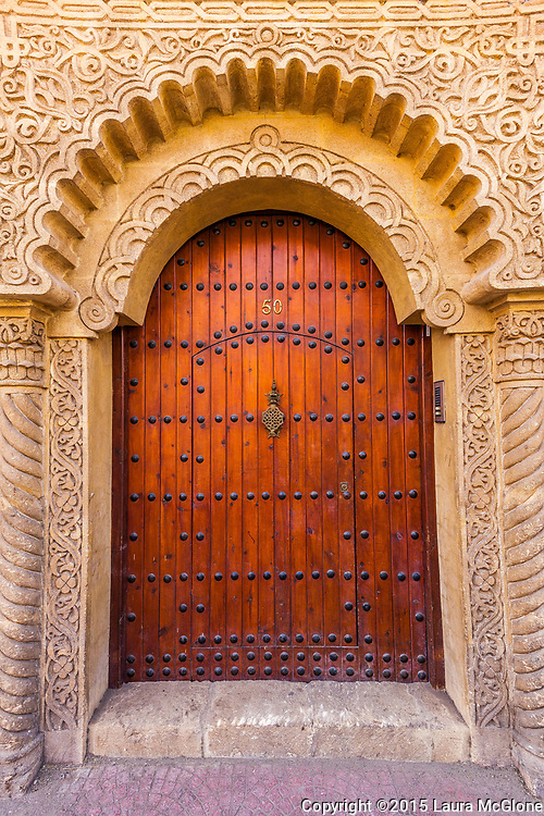 Moroccan Doorway in Fez, Morocco with wood and stone carvings