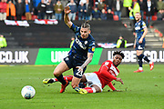 Kalvin Phillips (23) of Leeds United is tackled by Antoine Semenyo (18) of Bristol City during the EFL Sky Bet Championship match between Bristol City and Leeds United at Ashton Gate, Bristol, England on 9 March 2019.