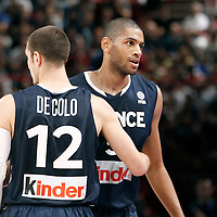 15 July 2012: Nicolas Batum of Team France is congratulated by Nando De Colo of Team France during a pre-Olympic exhibition game won 75-70 by Spain over France, at the Palais Omnisports de Paris Bercy, in Paris, France.
