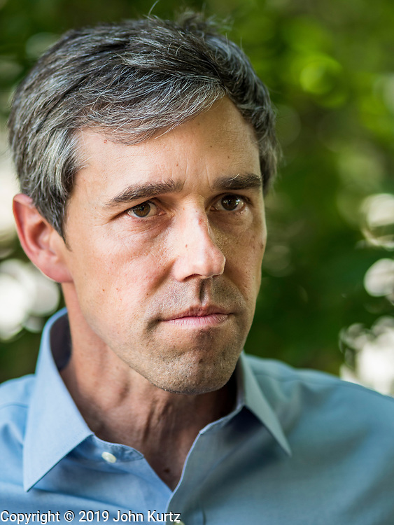 07 JUNE  2019 - LACONA, IOWA: BETO O'ROURKE, talks to reporters after touring Coyote Run Farm Friday. He talked to Matt Russell, the farm's co-owner, about the impact of President Trump's tariffs against China and proposed tariff's against Mexico on Iowa farmers and how climate change was changing American agriculture. O'Rourke, running to be the 2020 Democratic nominee for the US Presidency, has made climate change a central part of his campaign. Iowa traditionally hosts the the first selection event of the presidential election cycle. The Iowa Caucuses will be on Feb. 3, 2020.                               PHOTO BY JACK KURTZ