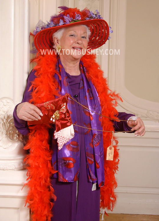 Middletown, N.Y. - A member of the Magenta Mammas of Newburgh, N.Y., poses for a photograph while rehearsing for a fashion show at Morrison Hall on the SUNY Orange campus on April 8, 2006. ©Tom Bushey