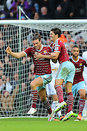 Andy Carroll of West Ham United is congratulated by team mate, James Tomkins after making the score 2-1 during the Barclays Premier League against Swansea City at the Boleyn Ground, London<br /> Picture by Richard Calver/Focus Images Ltd +447792 981244<br /> 07/12/2014